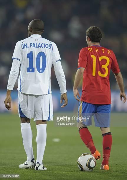 Honduras' midfielder Julio Cesar de Leon and Spain's striker Juan Manuel Mata react at the end of their Group H first round 2010 World Cup football...