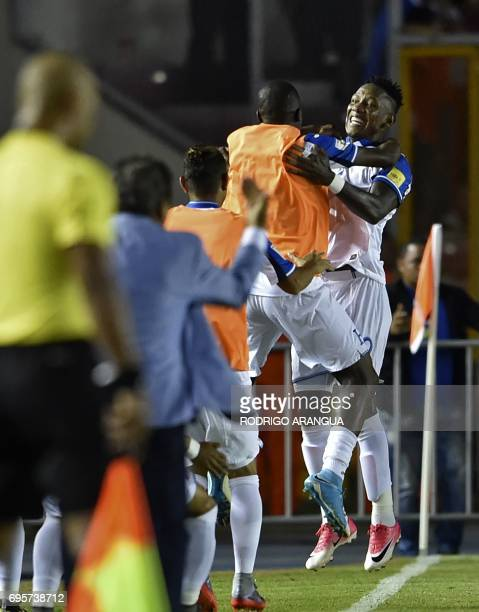 Honduras' midfielder Romell Quioto celebrates with teammates after scoring a goal against Panama during a FIFA World Cup Russia 2018 Concacaf...