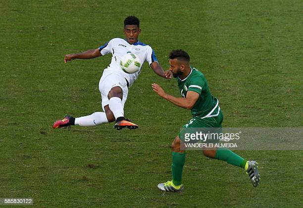 Honduras player Anthony Lozano vies for the ball with Algeria player Abdelghani Demmou during the Rio 2016 Olympic Games men's First Round Group D...