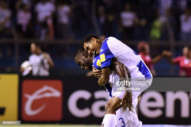 Honduras players celebrate after scoring against Mexico during their 2018 World Cup qualifier football match in San Pedro Sula Honduras on October 10...