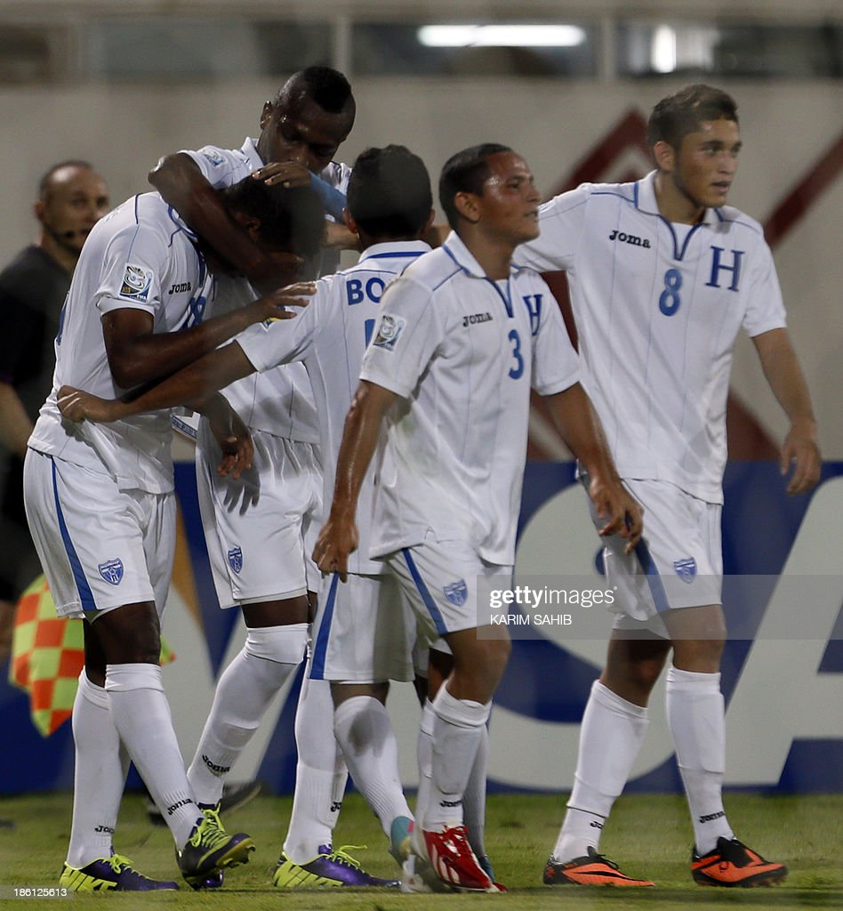 Honduras players celebrate after scoring against Uzbekistan during their FIFA U-17 World Cup UAE 2013 football match, on October 28, 2013, at the Sharjah Stadium in Sharjah. Honduras defeated Uzbekistan 1-0.
