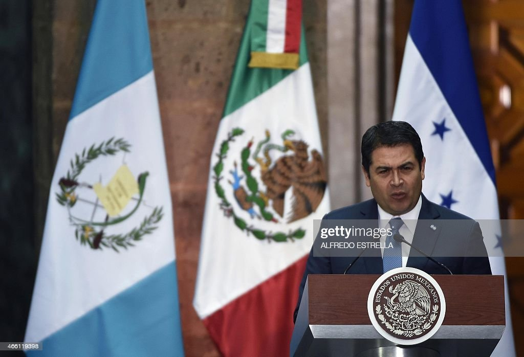 Honduras President Juan Orlando Hernandez delivers a speech after holding a meeting with his counterparts from Guatemalan Otto Perez Molina (L) and Mexico Enrique Pena Nieto, at the National Palace in Mexico City on March 13, 2015. Honduras is to join Mexico and Guatemala in a project for the construction of a gas pipeline. AFP PHOTO / ALFREDO ESTRELLA