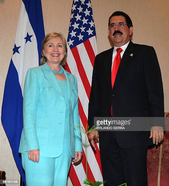 Honduras' President Manuel Zelaya says farewell to US Secretary of State Hillary Clinton before she leaves after attending the 39th General Assembly...