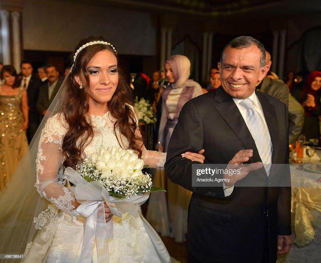 Hondura's President Porfirio Lobo (R) and his daugter Rosa Elana (L) attends Elana's wedding ceremony in Istanbul on December 14, 2013. Hondura's President Porfirio Lobo's daugter Rosa Elana (L) gets married with businesman Fetih Ozger's son Talha Ozger (R) in Kaya Ramada Hotel on December 14,2013 in Istanbul, Turkey.