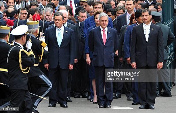 Honduras' President Porfirio Lobo Chile's President Sebastian Pinera and Ecuador's President Rafael Correa are followed by other world leaders as...