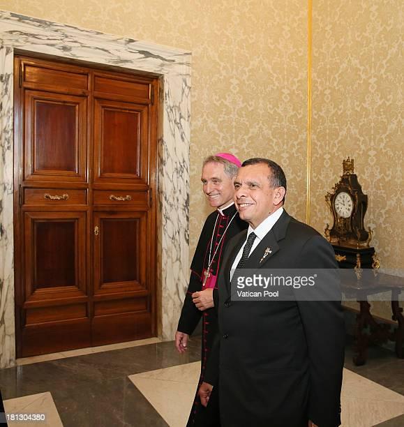 Honduras President Porfirio Lobo Sosa flanked by Prefect of the Pontifical House and former personal secretary of Pope Benedict XVI Georg Ganswein...