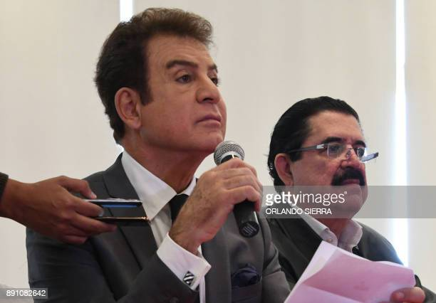 Honduras' presidential candidate for the Opposition Alliance against Dictatorship party Salvador Nasralla speaks with the press next to ousted...