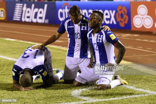 Honduras' Romell Quioto celebrates with teammates after scoring against Mexico during their 2018 World Cup qualifier football match in San Pedro Sula...