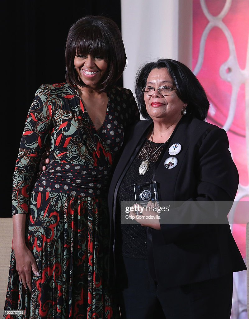 Honduras Truth and Reconciliation Commission member Julieta Castellanos (R) poses for photographs with U.S. first lady Michelle Obama after receiving the International Women of Courage award at the State Department March 8, 2013 in Washington, DC. In celebration of the 102nd International Women's Day, the State Department honored nine women from around the world with the International Women of Courage Award, including the 23-year-old Indian woman known only as 'Nirbhaya,' who died from injuries she received after being gang raped by six men last December in Delhi.