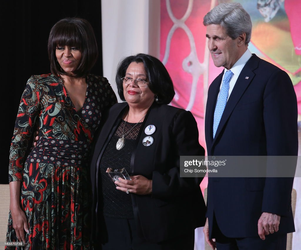 Honduras Truth and Reconciliation Commission member Julieta Castellanos (C) poses for photographs with U.S. first lady <a gi-track='captionPersonalityLinkClicked' href=/galleries/search?phrase=Michelle+Obama&family=editorial&specificpeople=2528864 ng-click='$event.stopPropagation()'>Michelle Obama</a> (L) and U.S. Secretary of State <a gi-track='captionPersonalityLinkClicked' href=/galleries/search?phrase=John+Kerry&family=editorial&specificpeople=154885 ng-click='$event.stopPropagation()'>John Kerry</a> after receiving the International Women of Courage award at the State Department March 8, 2013 in Washington, DC. In celebration of the 102nd International Women's Day, the State Department honored nine women from around the world with the International Women of Courage Award, including the 23-year-old Indian woman known only as 'Nirbhaya,' who died from injuries she received after being gang raped by six men last December in Delhi.