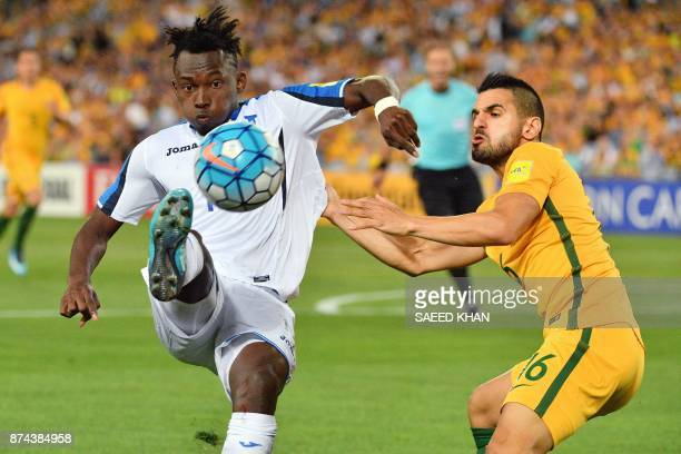 TOPSHOT Honduras's Alberth Elis fights for ball with Australia's Aziz Behich during their World Cup 2018 qualifying football match in Sydney on...