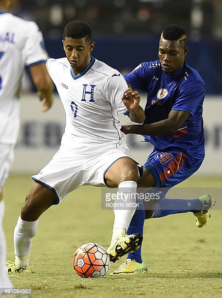 Honduras's Anthony Lozano is challenged by Haiti's Severe Verilus during their CONCACAF Men's Olympic Qualifying Group B Match October 2 at the Stub...