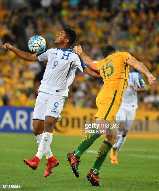 Honduras's Antony Lozano fights for ball with Australia's Mile Jedinak during the World Cup 2018 qualifying football match between Honduras and...