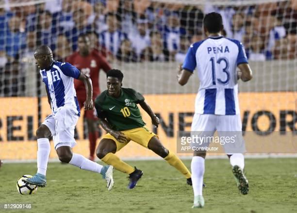 Honduras's midfielder Oscar Boniek vies for the ball with French Guiana's midfielder Loic Baal during the second half of the Honduras vs French...