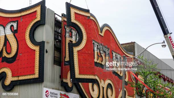 Honest Ed's store sign is removed by a Pattison Sign crew Crane lowers the first piece of the iconic sign The traditional Toronto landmark and famous...