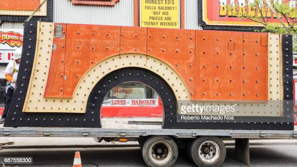 Honest Ed's store sign is removed Piece the iconic sign lowered to a truck The traditional Toronto landmark and famous place will be redeveloped with...