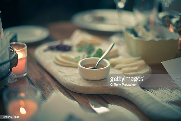 Honey and cheese platter on table