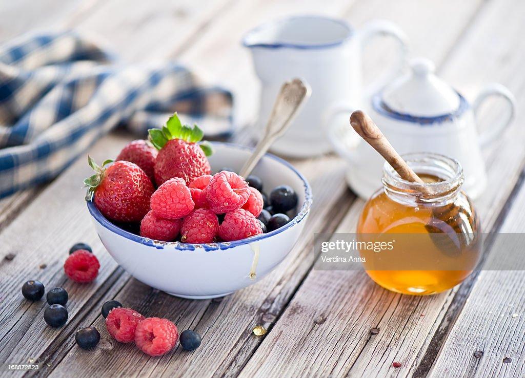 Honey and fresh berries : Stock Photo