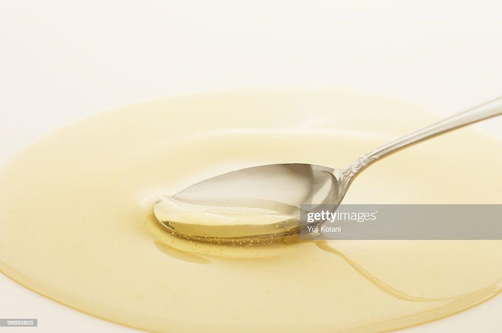 Honey and spoon : Stock Photo