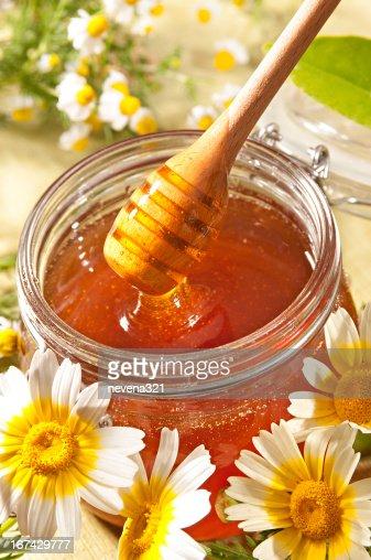 Honey and wildflowers : Stock Photo