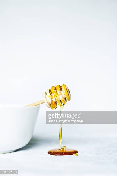 honey dripping from bowl