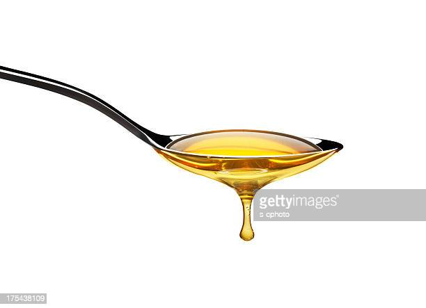 Honey dripping from spoon