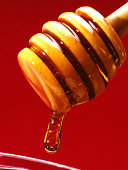 Honey dripping into jar