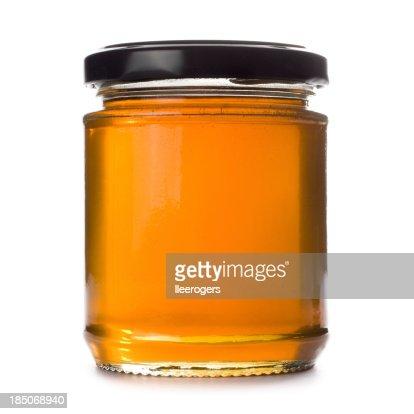 Honey jar on a white background
