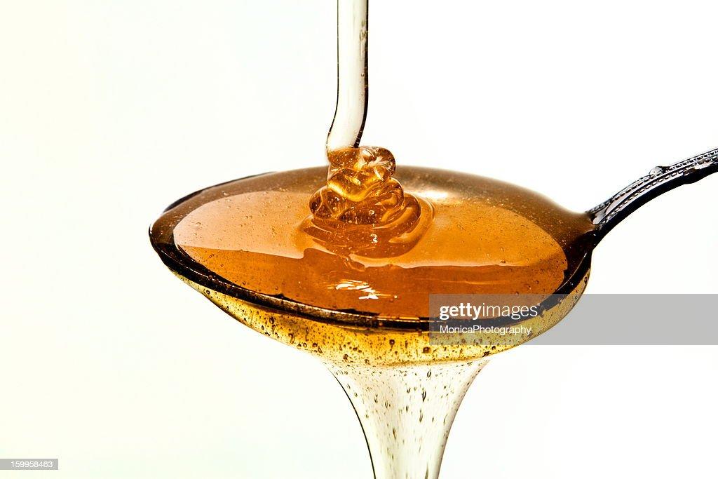 Honey on the spoon : Stock Photo
