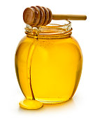 A jar of honey with a honey dipper.  Insert your own label or logo.  Isolated on a white background.