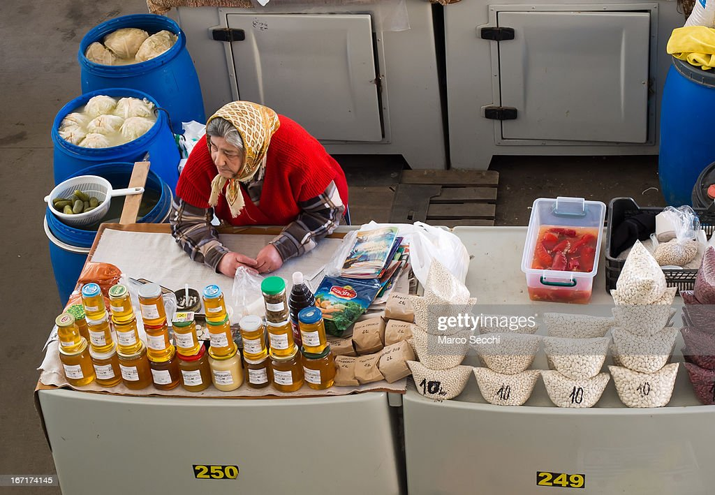 A honey seller sit at her stall at the daily market on April 15, 2013 in Timisoara, Romania. Romania has abandoned a target deadline of 2015 to switch to the single European currency and will now submit to the European Commission a programme on progress towards the adoption of the Euro, which for the first time will not have a target date.