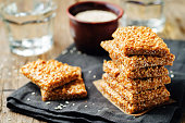 Honey sesame seed bars on a wood background. toning. selective focus