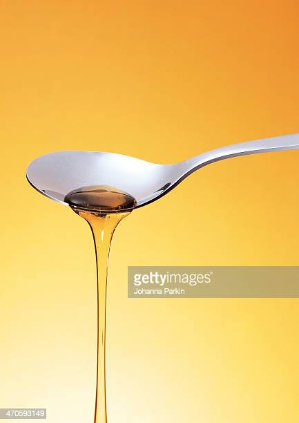 Honey / Syrup pouring off a spoon