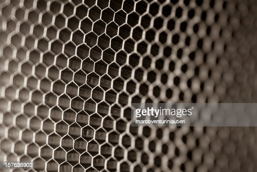 Honeycomb panel close-up, abstract texture with light