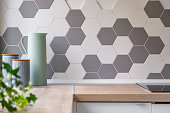 Kitchen with honeycomb wall tiles and wooden worktop