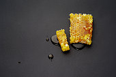 top view, honey bee flows out of honeycomb on a black background
