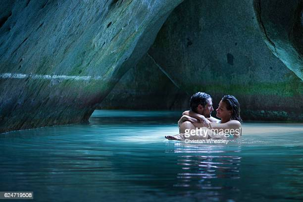 Honeymoon couple embracing in the cave at the Baths