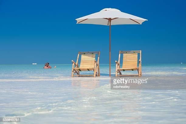honeymoon couple hugging on a tropical beach in Florida, USA