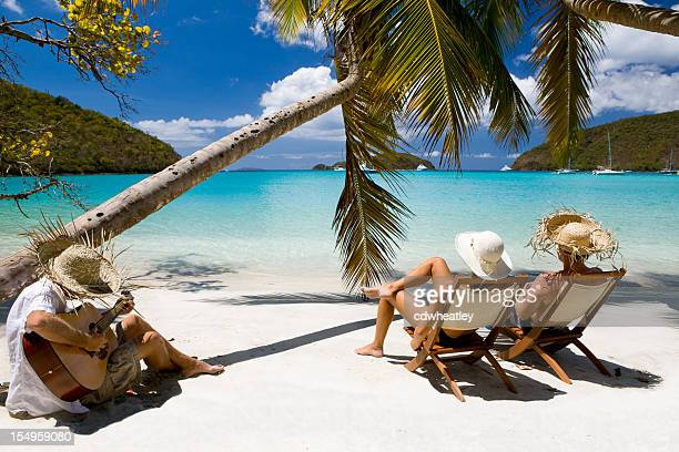 honeymoon couple relaxing at a beach in the Caribbean