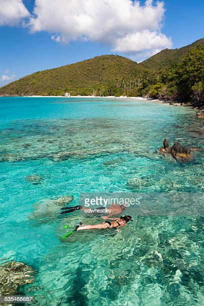 honeymoon couple snorkeling in the Caribbean crystal clear waters