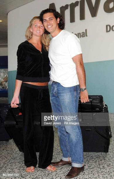 Honeymooners Kaye and Michael White from Derby arrive at Birmingham Airport after being stuck in Dubai