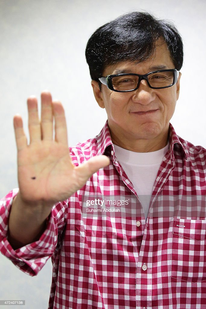 Hong actor and director, Jackie Chan poses for a photo prior to the launch of a new mobile anti-drug game application, Aversion at Nanyang Polytechnic on May 7, 2015 in Singapore. Jackie Chan was named Singapore's first celebrity anti-drug ambassador.