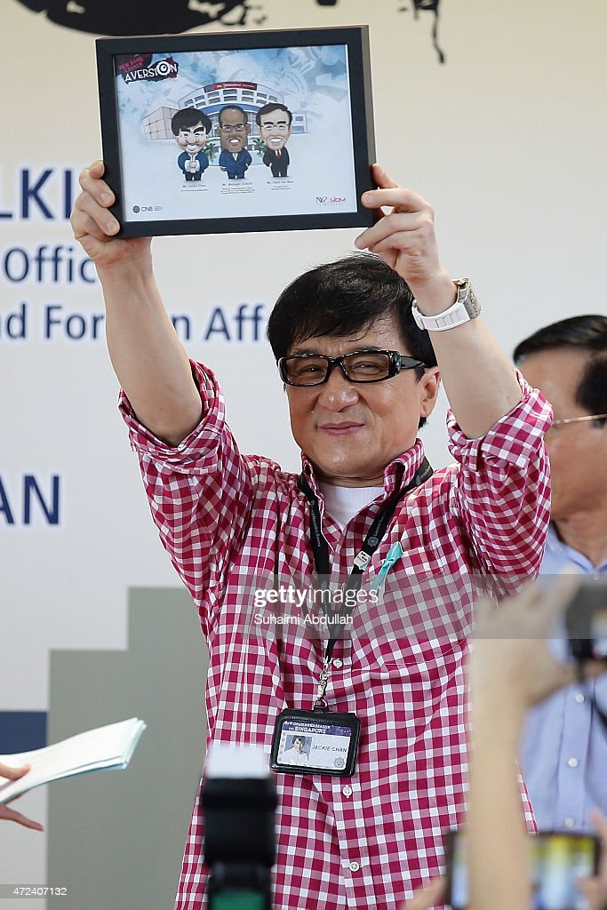 Hong actor and director, Jackie Chan receives a token of appreciation the launch of a new mobile anti-drug game application, Aversion at Nanyang Polytechnic on May 7, 2015 in Singapore. Jackie Chan was named Singapore's first celebrity anti-drug ambassador.