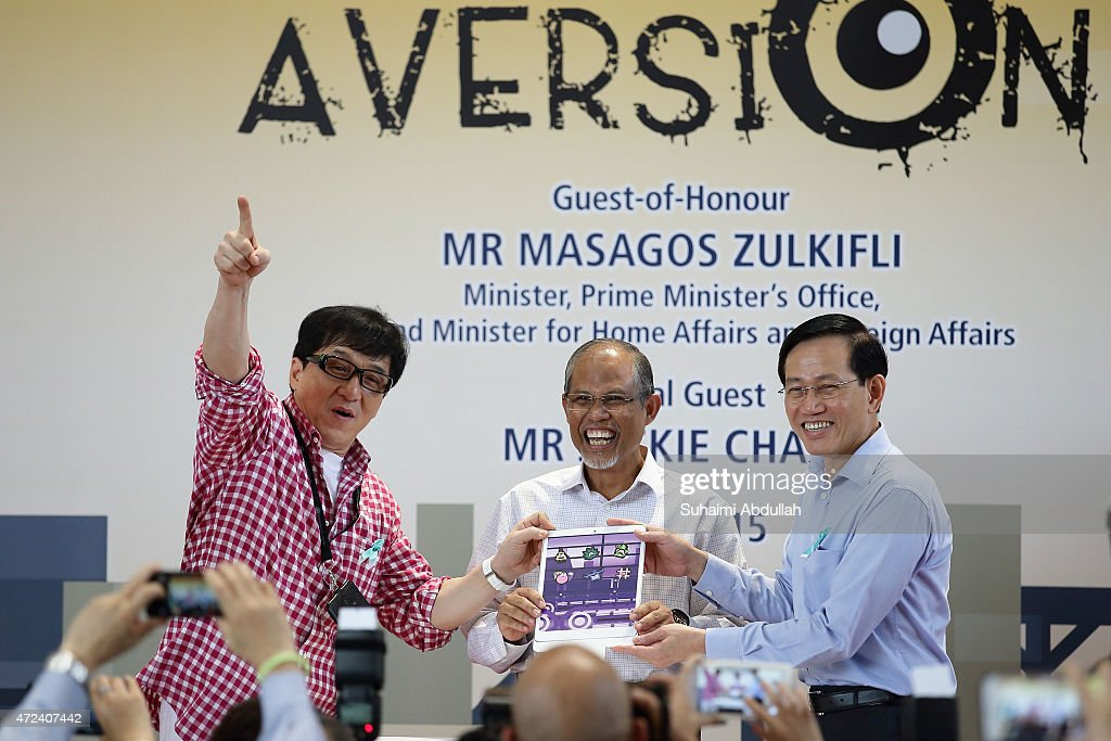 Hong actor and director , Jackie Chan , Second Minister for Home Affairs and Second Minister for Foreign Affairs, Masagos Zulkilfi and Principal & CEO of Nanyang Polytechnic, Mr Chan Lee Mun launch the new mobile anti-drug game application, Aversion at Nanyang Polytechnic on May 7, 2015 in Singapore. Jackie Chan was named Singapore's first celebrity anti-drug ambassador.