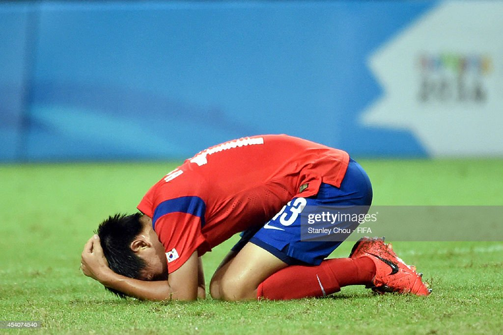 Hong Hyunseok of Korea Republic reacts after missing a goal scoring chance during the 2014 FIFA Boys Summer Youth Olympic Football Tournament Semi Final match between Korea Republic and Iceland at Jiangning Sports Centre Stadium on August 24, 2014 in Nanjing, China.