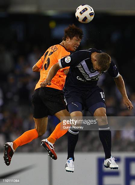 Hong Jeong Ho of Jeju heads the ball over the top of Danny Allsopp of the Victory during the AFC Champions League Group E match between the Melbourne...