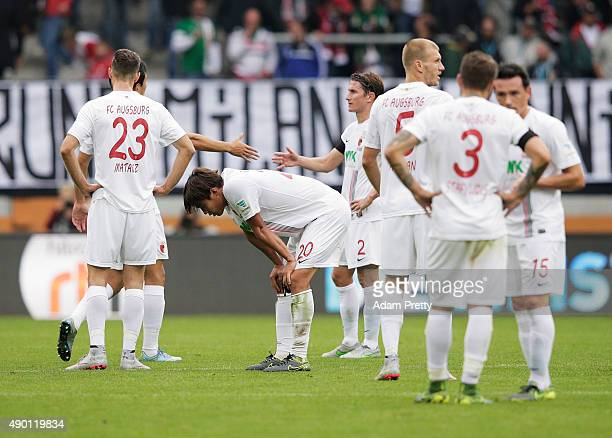 Hong JeongHo of Augsburg and team amates are dejected after losing the Bundesliga match between FC Augsburg and 1899 Hoffenheim at WWKArena on...