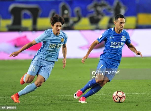 Hong Jeongho of Jiangsu Suning and Eran Zahavi of Guangzhou RF compete for the ball during the 6th round match of China Super League between Jiangsu...