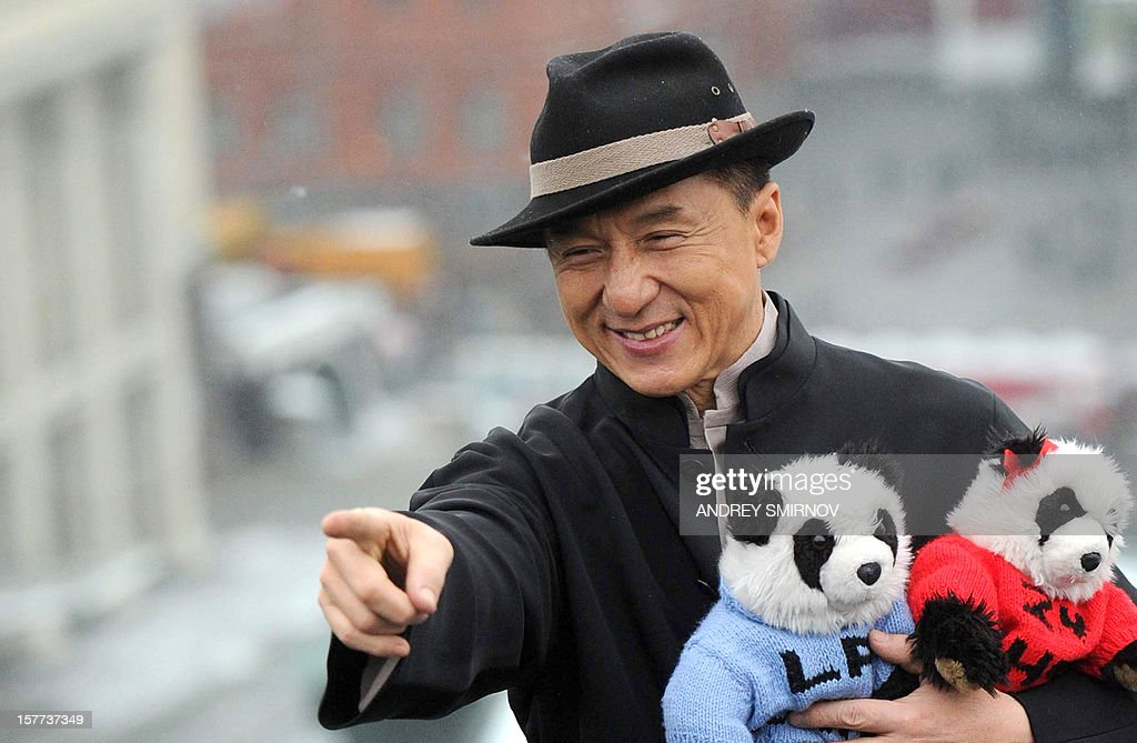 Hong Kong action film star Jackie Chan holds toy pandas as he poses for photos atop a hotel roof just outside the Kremlin in Moscow, on December 6, 2012. Jackie Chan arrived in Moscow to promote his new film 'Chinese Zodiac,' also known as 'Armour of God