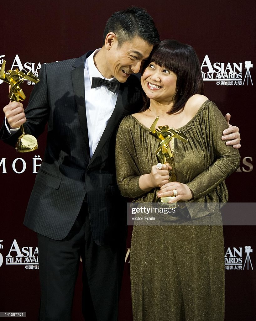 Hong Kong actor <a gi-track='captionPersonalityLinkClicked' href=/galleries/search?phrase=Andy+Lau&family=editorial&specificpeople=171171 ng-click='$event.stopPropagation()'>Andy Lau</a> and Philippine actress Eugene Domingo pose with their trophies after winning the most popular actor and actress awards during the 6th Asian Film Awards, celebrating excellence in cinema, at Hong Kong Convention and Exhibition Center on 19 March 2012 in Hong Kong, China The event honours specifically filmmakers achievements in the field of Asian cinema, bringing together the best cinematic talent in Asia.